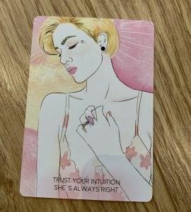 """An oracle card with a blonde lady on it that says """"Trust your intuition, she's always right."""""""